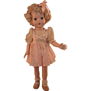 """Honey doll marked  Effanbee and is 16"""" tall circa 1949-1958 in original dress good condition. - Red Tag Sale Item"""