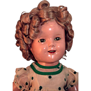 "Shirley Temple composition 18"" tall marked doll by Ideal with replaced vintage green polka dot dress untagged in very good condition."