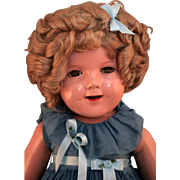 """Shirley Temple flirty eye marked composition doll 27"""" tall by Ideal in very good condition with original tagged dress. - Red Tag Sale Item"""