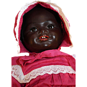 "Kammer and Reinhardt rare black character painted bisque baby doll with cloth body 18"" tall."