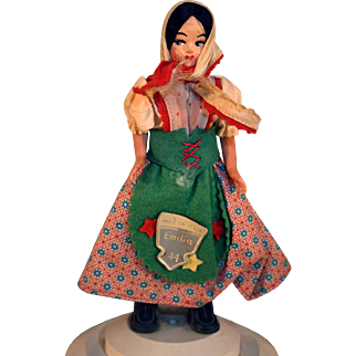 """Plastic doll 6-1/2"""" tall is made in Italy and is musical. Circa 1950's  or 1960's original tag"""