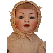 "Antique German bisque character face baby/toddler doll 15"" on 5 piece compo body.  No marks."