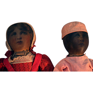 Early Babyland rag doll pair with life-like printed faces from approximately 1893
