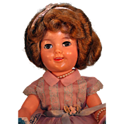 "Shirley Temple vinyl doll 17"" tall by Ideal from 1950's with original tagged outfit."