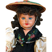"French painted bisque 11"" tall French provincial regional costumed doll from approximately 1920's - 1930's."