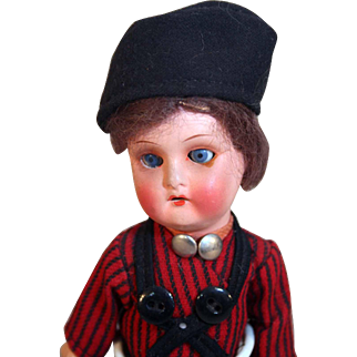 """Painted bisque vintage boy doll 9"""" marked 251-17 10 with vintage clothing."""