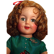 "Shirley Temple vinyl doll by Ideal 19"" tall original tagged plaid dress Circa 1950's in good condition."