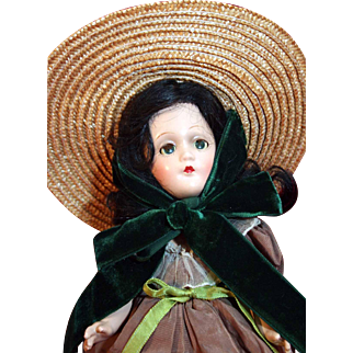 """Scarlett O'Hara 11"""" tall composition doll by Madame Alexander from 1937-1946 in good condition with tagged dress."""