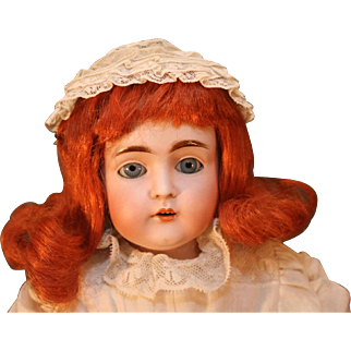 """Antique bisque head shoulder plate doll by Kestner in Germany that is 24"""" long from 1892."""
