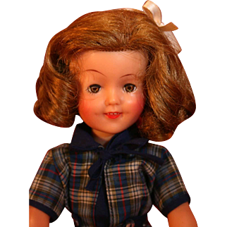 """Shirley Temple vinyl doll 12"""" tall Circa 1950's by Ideal in good condition."""