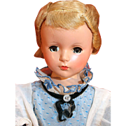 """Madame Alexander 14"""" tall hard plastic blonde doll from 1948-1956 dressed as Alice in Wonderland."""