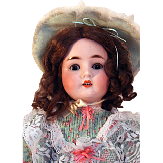 """Pansy IV German bisque antique doll 23"""" tall with mint green floral dress."""