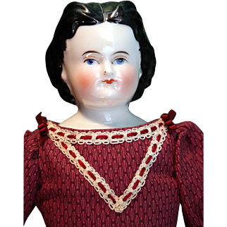"Antique china head 14"" long doll is known as Adelina Patti is in good condition."