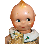 """Composition Kewpie jointed doll 12"""" tall by Rose O'Neil that is vintage."""
