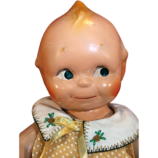 "Composition Kewpie jointed doll 12"" tall by Rose O'Neil that is vintage."