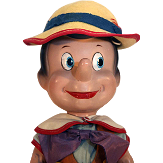 "Knickerbocker Pinocchio composition character from Disney that is 14"" tall, jointed and in good condition."