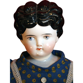 "Low brow hair style china head doll from 1890s 15"" tall in good condition."