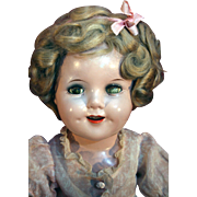 """Shirley Temple all original composition doll 18"""" tall in very good condition with original dress frm mid 1930's."""