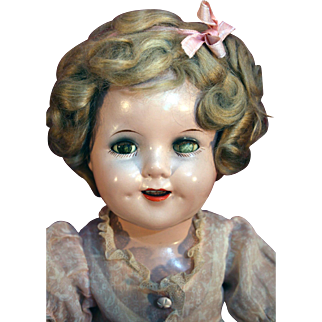 "Shirley Temple all original composition doll 18"" tall in very good condition with original dress frm mid 1930's."