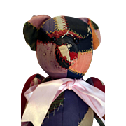 """Vintage 16"""" tall crazy quilt covered teddy bear that is jointed."""