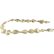 Better than beachcombing. 14k Seashell bracelet