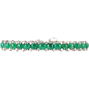 Vibrant 28 Carat Cabochon Emerald and 2.3 Carat Diamond 18K Gold Bracelet