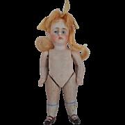 An antique all-bisque dolls' house doll, possibly Kestner