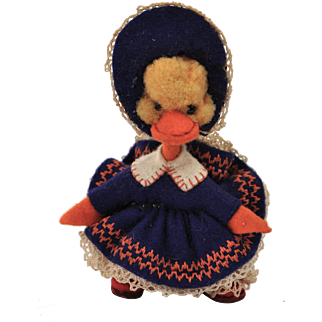 A lovely miniature woolen pom-pom duckling dressed as a crinoline lady, 1950s
