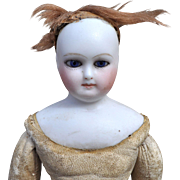 An antique French pressed bisque shoulder-head fashion doll,