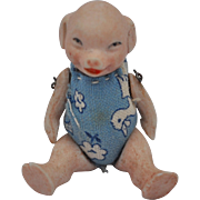 A rare Hertwig all-bisque pig doll,