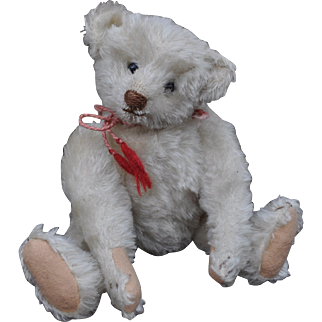 An extremely rare small size and fine antique Steiff white mohair teddy bear, circa 1906