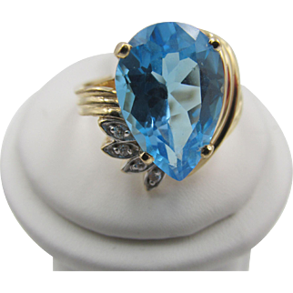 Impressive Blue Pear Shaped Topaz Diamond 14k ring