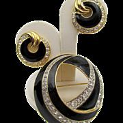 Trifari Black Enamel and Crystal Rhinestone Swirled Brooch and Earrings