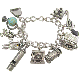 Danecraft Sterling Charm bracelet with 11 Moveable Mechanical Charms