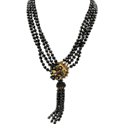 Vintage Black Jet Beaded Sautoir Necklace with Floral Gilt Clasp and Tassel.