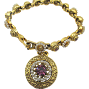 Vintage Signed ART Gold Plated Seed Pearl and Purple Rhinestone Charm Bracelet