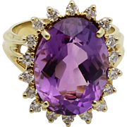 Vintage Oval Amethyst and Diamond Halo Ring in 18k Yellow Gold