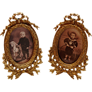 Pair of Antique gilt metal picture frames with Victorian children