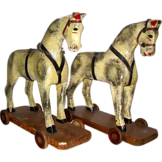 2 wooden horses on wheels, by Lines brothers