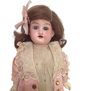 All original AM 390 bisque headed doll