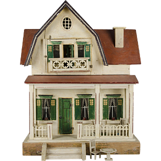 A Schönherr red-roofed dolls' house c.1920's 28.5 inches tall