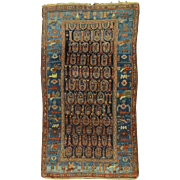 An early 20th C. Persian Village Rug with Boteh Decoration