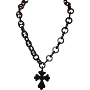 Early 20th century plastic cross necklace