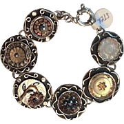 Sterling bracelet with antique French mop buttons