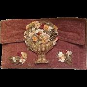 Wonderful fabric purse with ribbon detail.