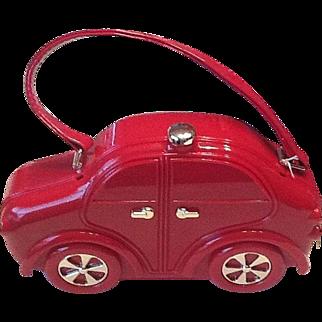 Red hard plastic handbag