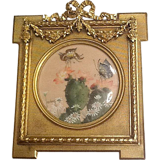 Small bronze hanging frame with painting