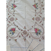 Vintage cross stitch and embroidered tablecloth