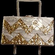 Plastic and gold confetti purse