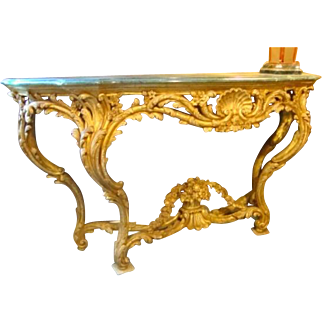 A Magnificent Louis XV carved and gilded console table.